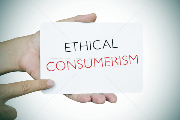man with a signboard with the text ethical consumerism, vignette Stock photo © nito
