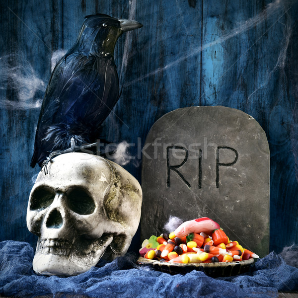 crow, skull, gravestone and Halloween candies Stock photo © nito
