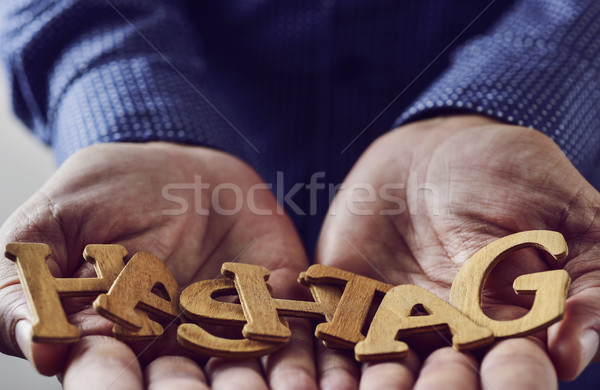 word hashtag in the hands of a man Stock photo © nito