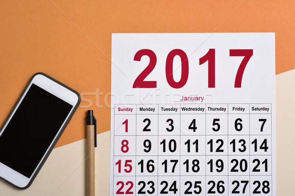 Naptár irodai asztal lövés okostelefon toll asztal Stock fotó © nito
