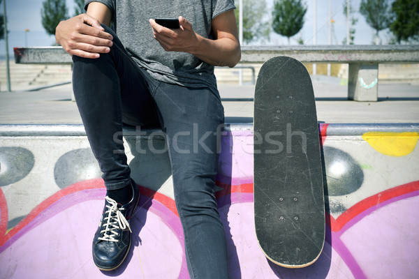 skater man using his smartphone Stock photo © nito
