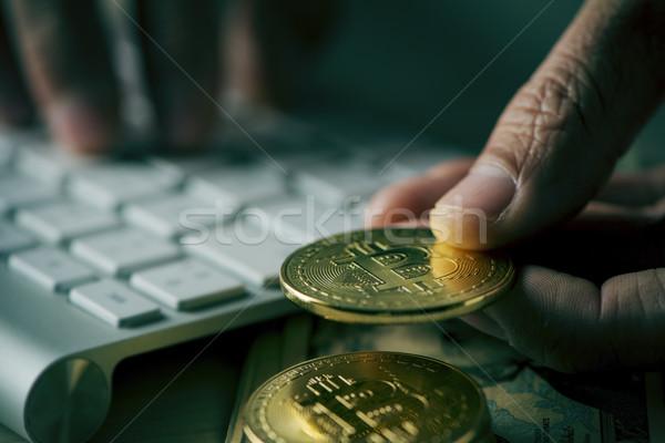 bitcoins and man using computer Stock photo © nito