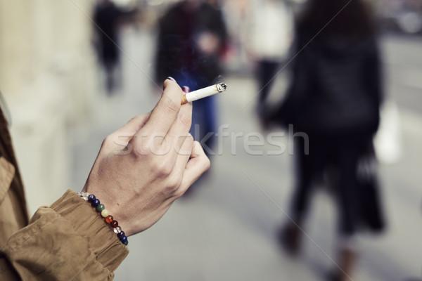 Genç kadın sigara içme sigara genç kafkas Stok fotoğraf © nito