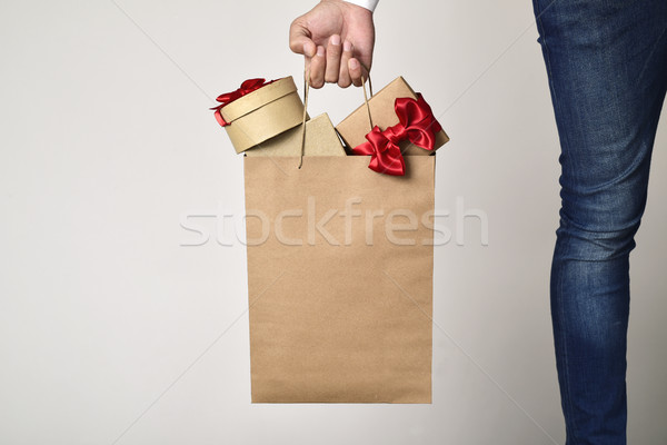 man with a shopping bag full of gifts Stock photo © nito
