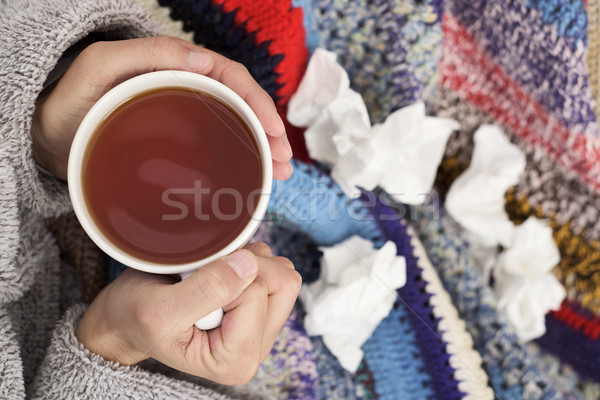 ill man warming up with a cup of tea Stock photo © nito