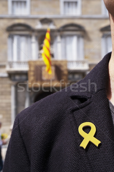 man with a yellow ribbon in Barcelona, Spain