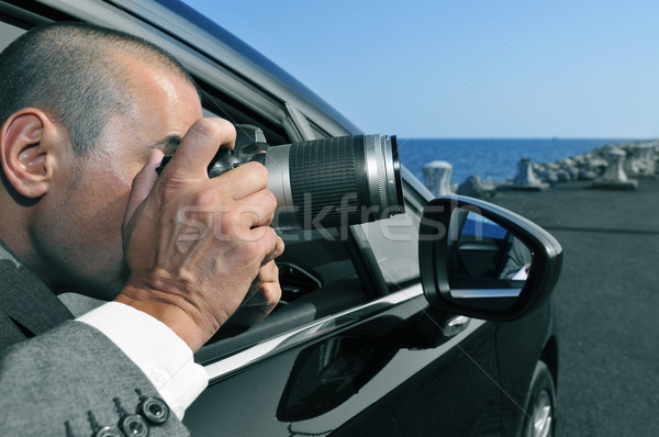 Stock photo: detective or paparazzi taking photos from inside a car