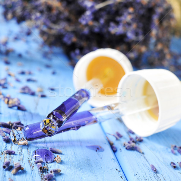 Stock photo: pipettes with flower essence and lavender flowers