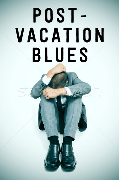 text post-vacation blues and a businessman curled up with his he Stock photo © nito