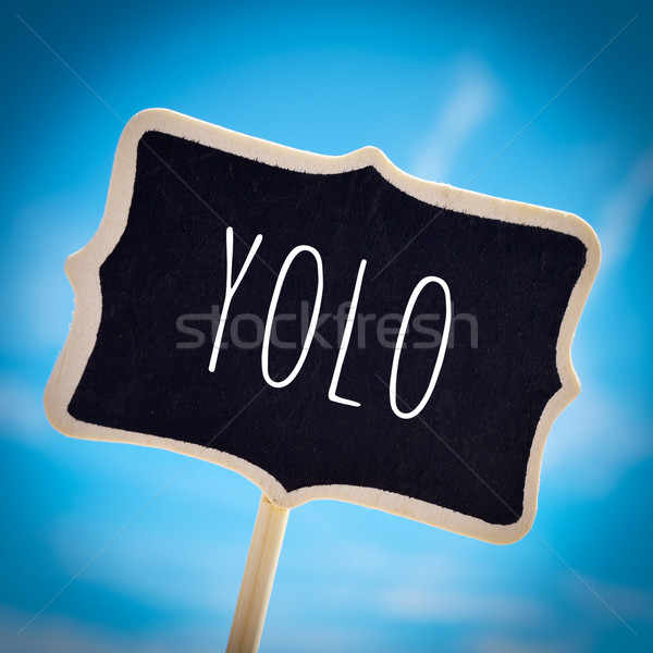 signboard with the word yolo, vignetted Stock photo © nito