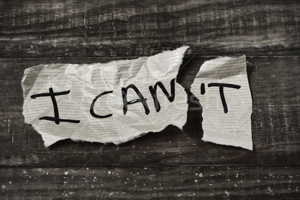 Stock photo: text I can in a piece of paper, black and white
