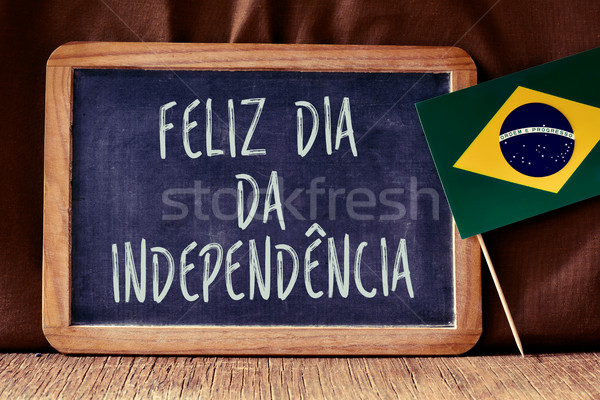 text Feliz Dia da Independencia and Brazilian flag Stock photo © nito