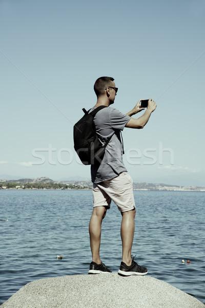 man taking a photo of the sea in Sardinia, Italy Stock photo © nito