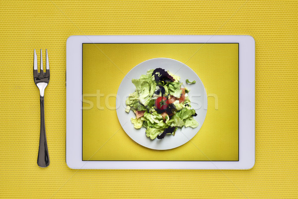 green salad in a digital tablet Stock photo © nito
