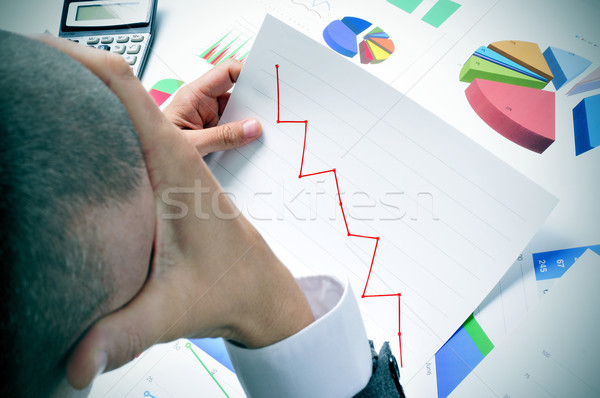businessman observing a chart with a downward trend Stock photo © nito