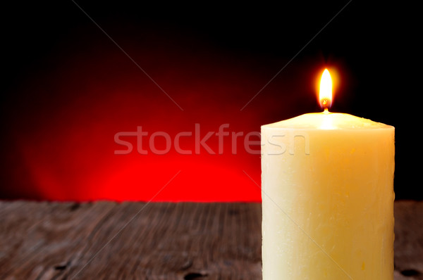 lit candle on a rustic wooden table Stock photo © nito