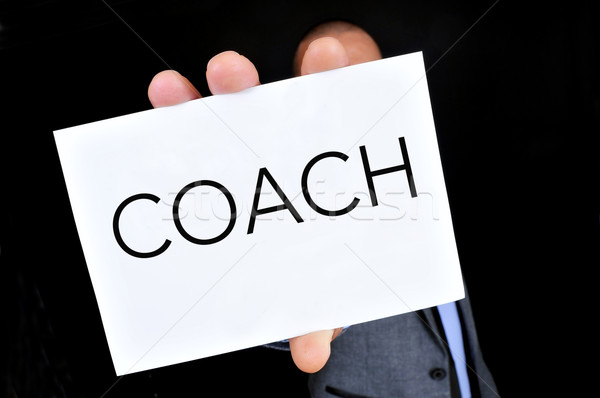 young man with a signboard with the word coach Stock photo © nito