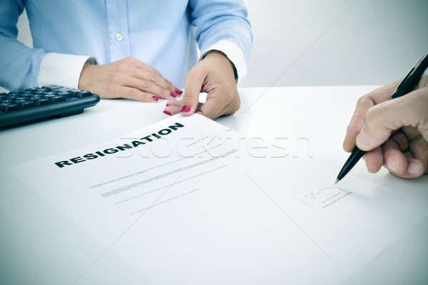 man signing a resignation document Stock photo © nito