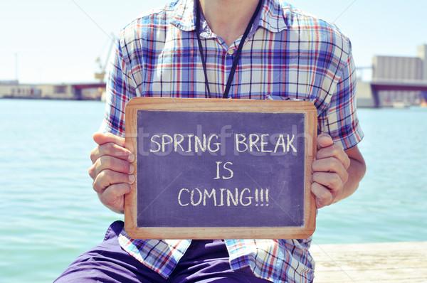 Fiatalember tábla szöveg tavaszi szünet fiatal kaukázusi Stock fotó © nito