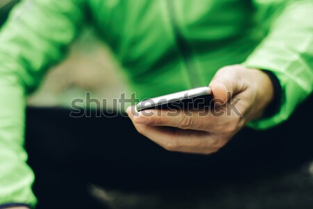 young sportsman using his smartphone Stock photo © nito