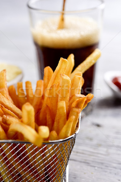 appetizing french fries in a metallic basket Stock photo © nito