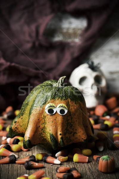 pumpkin with funny eyes, candies and skull Stock photo © nito