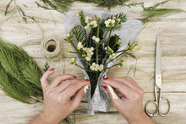 woman arranging a bunch of mistletoe Stock photo © nito