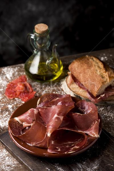 Serrano ham plaat rustiek houten tafel Stockfoto © nito