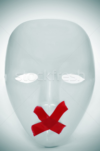 mask with its mouth shut with red tape Stock photo © nito