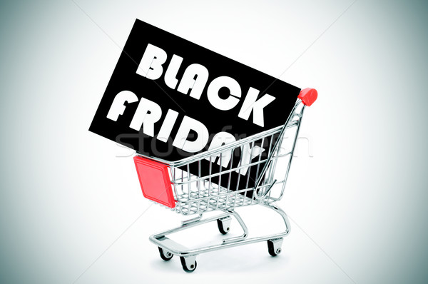 signboard with the text black friday in a shopping cart, vignett Stock photo © nito