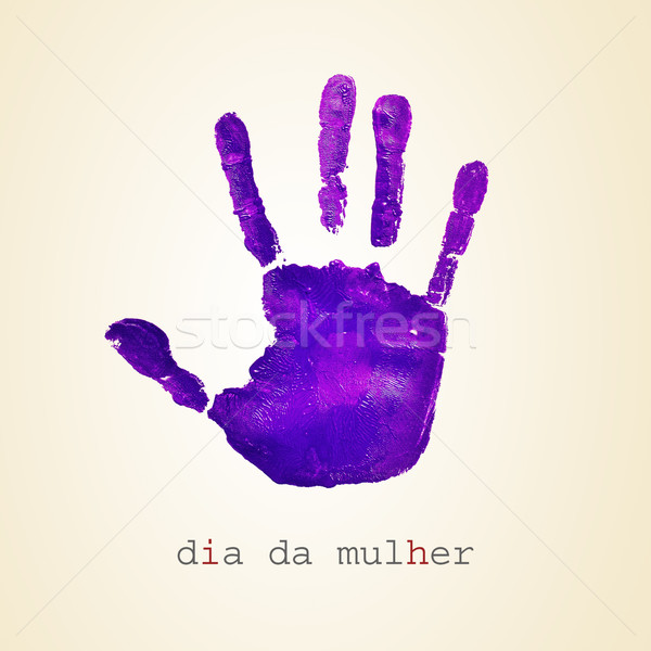 violet handprint and text dia da mulher, womens day in portugues Stock photo © nito