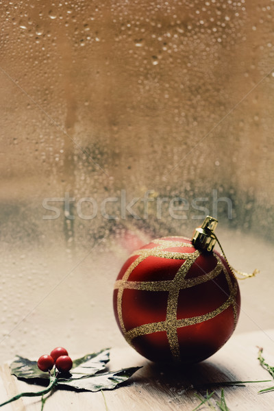 holly and christmas ball in a rainy day Stock photo © nito