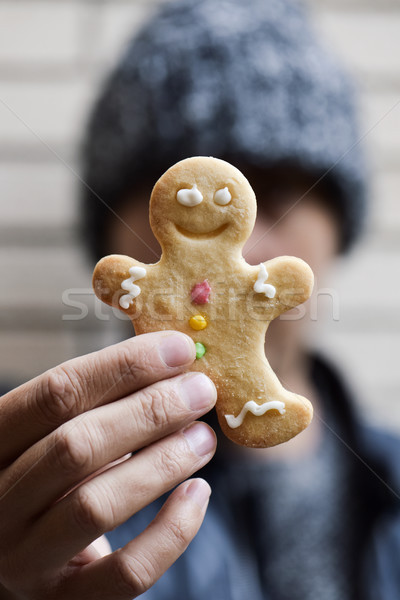 man with a gingerbread man cookie Stock photo © nito