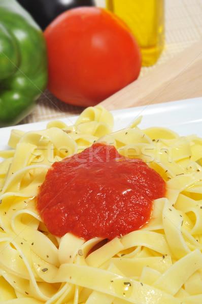 Tagliatelle plaka domates sosu keklikotu arka plan makarna Stok fotoğraf © nito