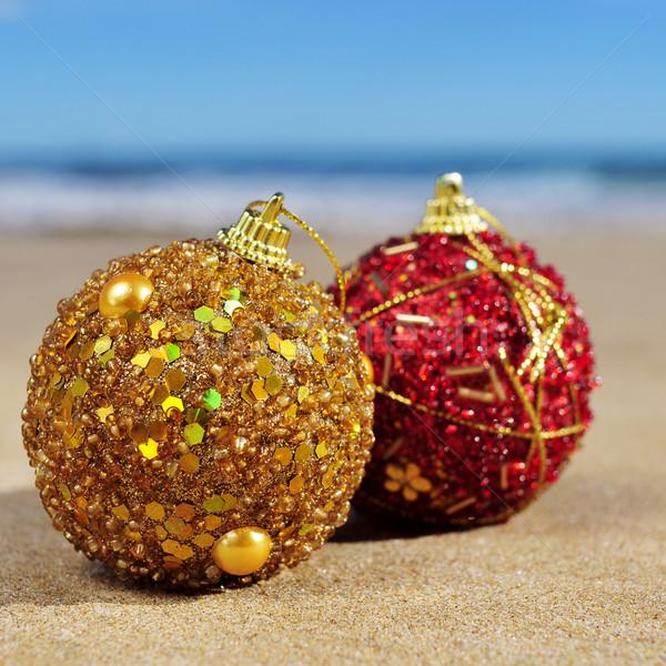 ornamented christmas balls on the beach Stock photo © nito