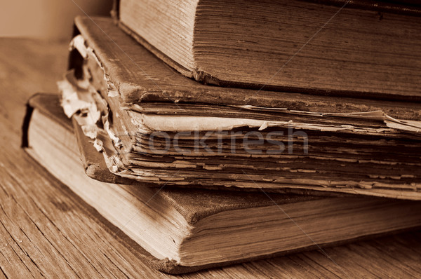 old books on a rustic wooden table, sepia toning Stock photo © nito