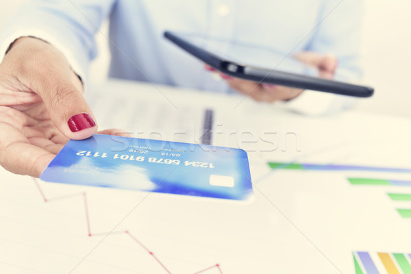young woman at her office desk with a credit card Stock photo © nito