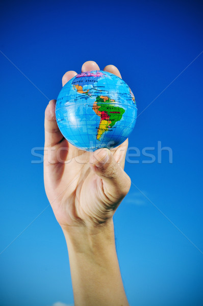 young man with a world globe in his hand, vignetted Stock photo © nito
