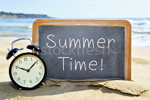 alarm clock and chalkboard with the text summer time Stock photo © nito