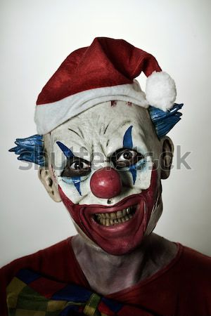 evil clown using a smartphone Stock photo © nito