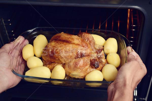 young man preparing a roast turkey Stock photo © nito