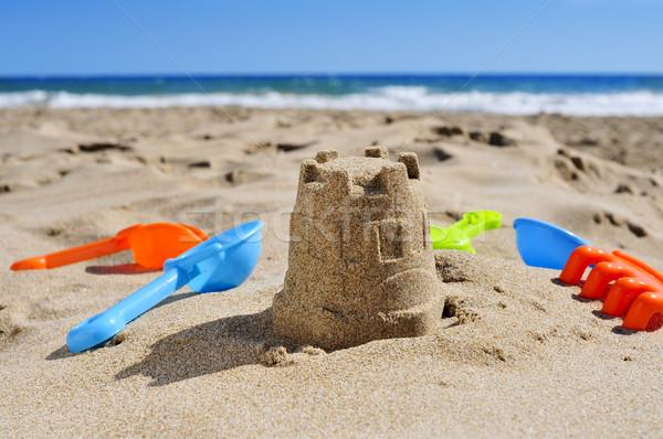 двухуровневый стробирующий импульс игрушку песок пляж лет синий Сток-фото © nito