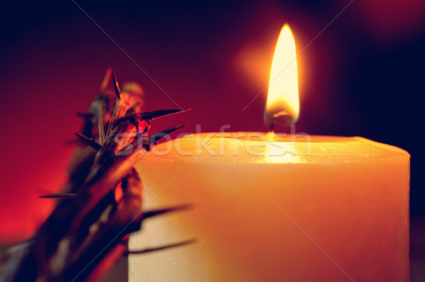 the crown of thorns of Jesus Christ and a lit candle Stock photo © nito