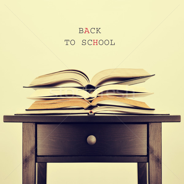 open books on a table and text back to school, with a retro effe Stock photo © nito