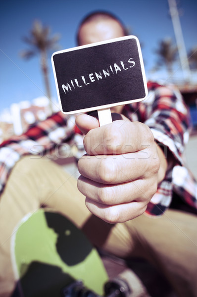skater shows a signboard with the text millennials Stock photo © nito