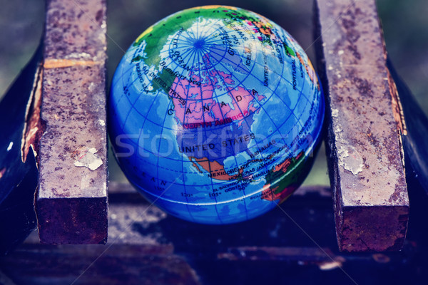 world globe in a vise Stock photo © nito