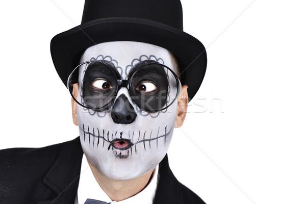 man with a mexican calaveras makeup crossing his eyes Stock photo © nito