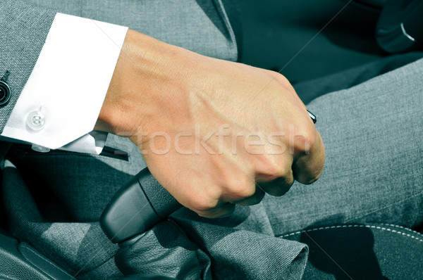 man in suit pulling the hand brake of a car Stock photo © nito