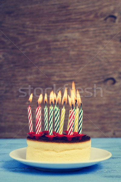 lighted birthday candles on a cheesecake, with a retro effect Stock photo © nito