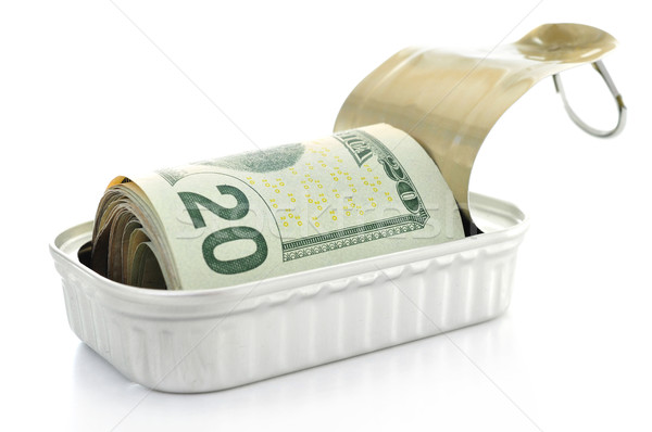 Stock photo: US dollar bills in a can